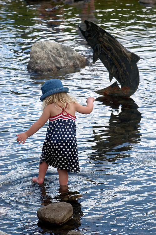 A girl plays in the Blue River in Breckenridge, Colorado