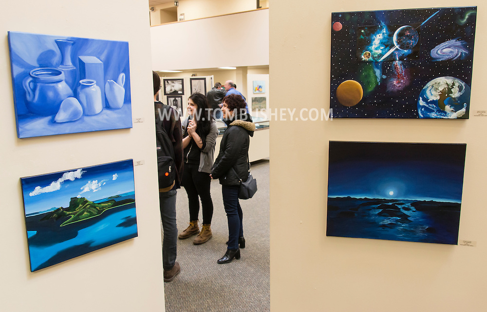 Middletown, New York - People look at exhibits during ARTiculate, the 11th annual SUNY Orange Student Art Show at the Orange Hall Gallery on April 8, 2015.