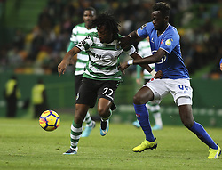 December 1, 2017 - Lisbon, Portugal - Sporting's forward Gelson Martins (L) vies with Belenenses's midfielder Bouba Sare during the Portuguese League  football match between Sporting CP and CF Belenenses at Jose Alvalade  Stadium in Lisbon on December 1, 2017. (Credit Image: © Carlos Costa/NurPhoto via ZUMA Press)