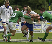 © Peter Spurrier / Intersport images.email images@intersport-images.com.29/6/03 Photo Peter Spurrier.IRB U21 Rugby World Cup - Henley - Oxon.Ireland v Italy.Mirco Bergamasco running with the ball, looks for the gap betweem Eugene McGoven [right] and Michael Riley