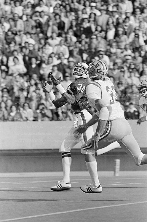 EL PASO, TX -  DECEMBER 31:  Wide receiver James Lofton #30 of Stanford University catches a touchdown pass during the 1977 Sun Bowl against the LSU Tigers played at Sun Bowl Stadium at the University of Texas at El Paso on December 31, 1977.  Jackie Casanova #33 of LSU defends.  Lofton later played in the NFL and is a member of the Pro Football Hall of Fame. (Photo by David Madison/Getty Images) *** Local Caption *** James Lofton