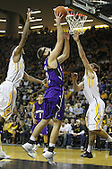 January 12 2010: Northwestern Wildcats center Luka Mirkovic (12) puts up a shot between Iowa Hawkeyes forward Melsahn Basabe (1) and Iowa Hawkeyes guard/forward Eric May (25) during the second half of an NCAA college basketball game at Carver-Hawkeye Arena in Iowa City, Iowa on January 12, 2010. Northwestern defeated Iowa 90-71.