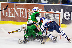 7.12.2012, Hala Tivoli, Ljubljana, SLO, EBEL, HDD Telemach Olimpija Ljubljana vs KHL Medvescak Zagreb, 28. Runde, in picture Adam Naglich (KHL Medvescak Zagreb, #7) crashes near the vs Jerry Kuhn (HDD Telemach Olimpija, #35) and Igor Cvetek (HDD Telemach Olimpija, #4) during the Erste Bank Icehockey League 28th Round match between HDD Telemach Olimpija Ljubljana and KHL Medvescak Zagreb at the Hala Tivoli, Ljubljana, Slovenia on 2012/12/07. (Photo By Matic Klansek Velej / Sportida)