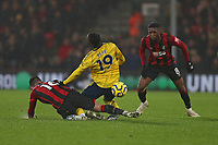 Football - 2019 / 2020 Premier League - AFC Bournemouth vs. Arsenal<br /> <br /> Bournemouth's Lewis Cook fouls Nicolas Pepe of Arsenal to stop a late Arsenal attack at the Vitality Stadium (Dean Court) Bournemouth <br /> <br /> COLORSPORT/SHAUN BOGGUST