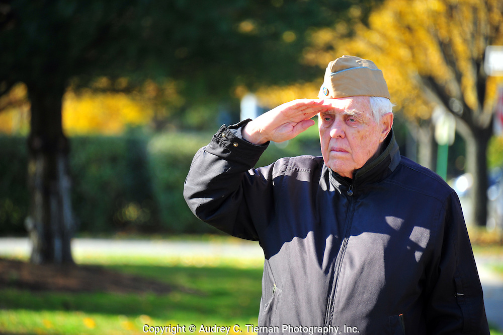 Garden City, NY:  Friday, November 11, 2011---  James A. Gray, a World War II veteran salutes the flag as the national anthem is played at a local Veterans Day ceremony.  Gray was held as a prisoner of war in Germany during the war.  © Audrey C. Tiernan