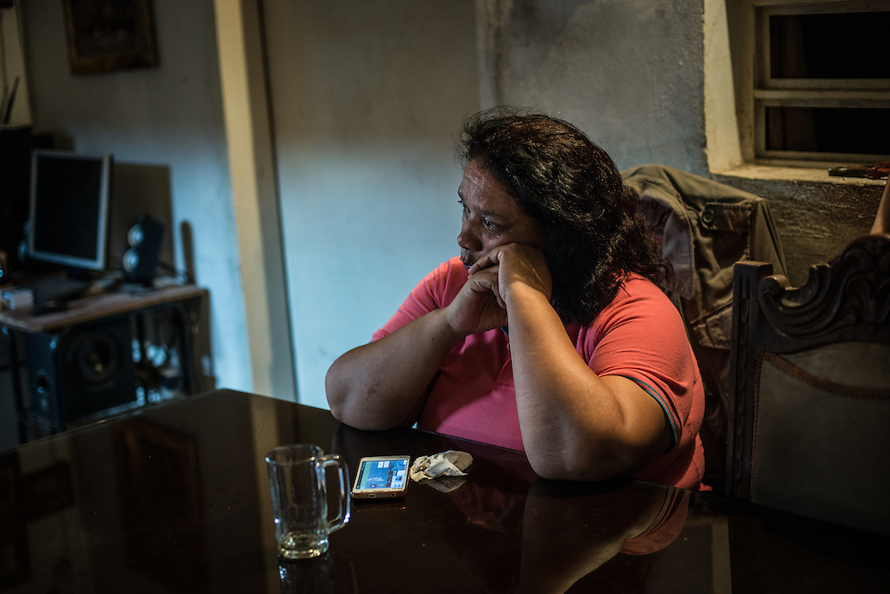 "MARACAY, VENEZUELA - JULY 15, 2016: Evelin RodrÍguez cries in frustration while explaining how difficult her life is caring for her two schizophrenic sons, Gerardo and Accel, in a country suffering from severe shortages of medicines, including the psychiatric drugs that she needs to keep her sons' conditions stabilized. It is an exhausting task taking care of them and going from pharmacy to pharmacy for hours searching for the medicines that her sons need, that she is rarely able to find. She copes by reducing their doses, and by sharing their prescriptions depending on which son needs the medicine the most each day. Evelin is a lawyer, but has quit all of her work since Accel attempted to cut off his arm after three weeks without his medicine. Evelin now spends her days looking after Accel and Gerardo, too afraid to leave them alone because they might hurt themselves.  ""I am tired,"" she said. ""This is too much sometimes"". PHOTO: Meridith Kohut for The New York Times"