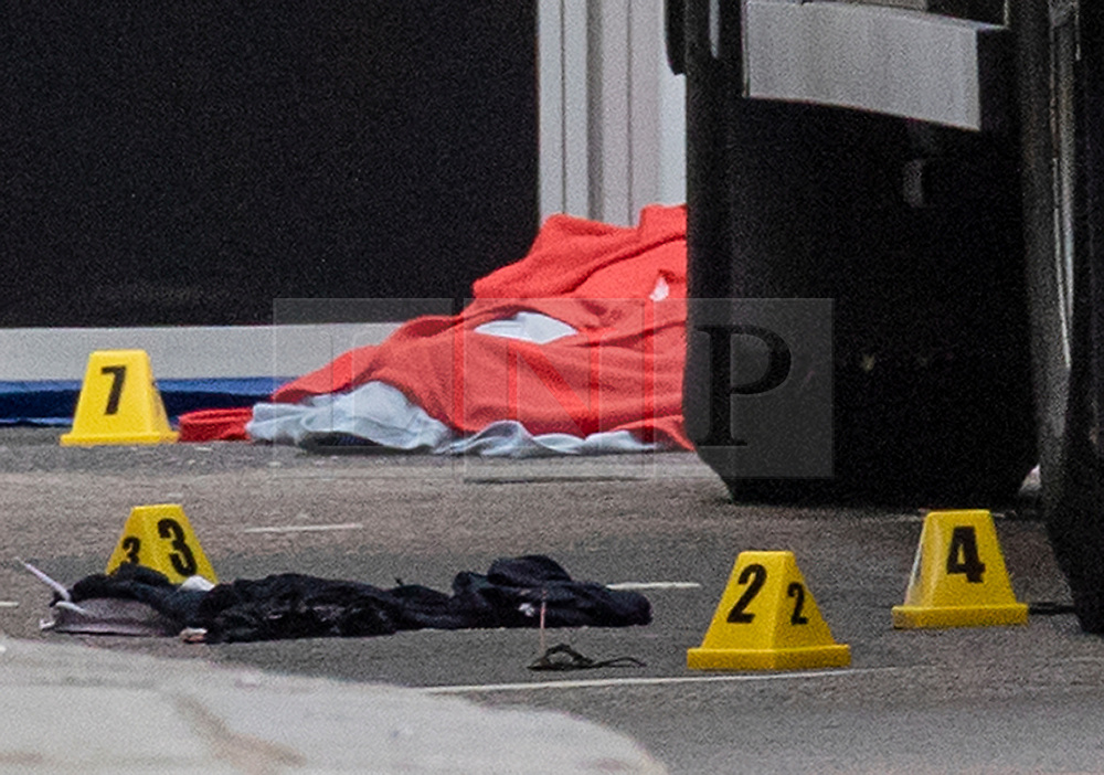 © Licensed to London News Pictures. 15/08/2018. London, UK. Evidence markers and blankets at the scene of an accident at Holborn where a cyclist has died after being hit by a lorry - believed to be former doctor to the Queen Peter Fisher. Photo credit: Rob Pinney/LNP