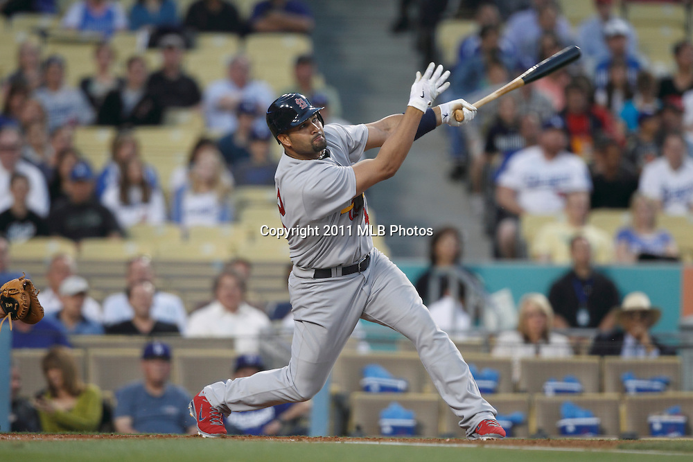LOS ANGELES, CA - APRIL 15:  Albert Pujols #5 of the St. Louis Cardinals takes a swing at a pitch during the game between the St. Louis Cardinals and the Los Angeles Dodgers on Friday April 15, 2011 at Dodger Stadium in Los Angeles, California. (Photo by Paul Spinelli/MLB Photos via Getty Images) *** Local Caption *** Albert Pujols