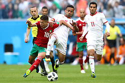 Morocco's Amine Harit (left) and Iran's Omid Ebrahimi battle for the ball