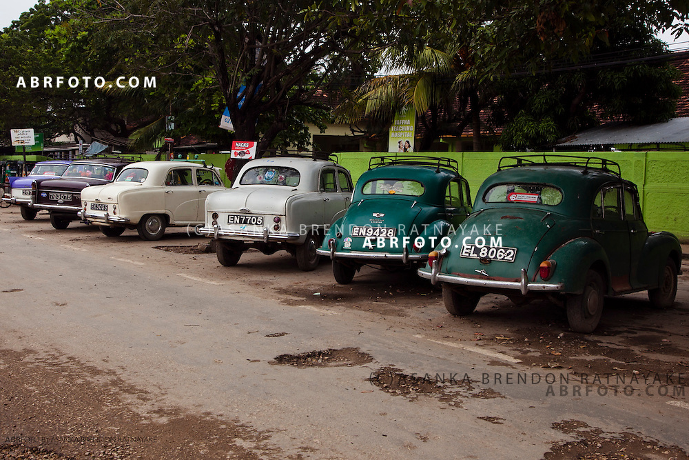 British cars such as the Morris Minor & Austin Cambridge parked on the Jaffna high street of Hospital Road.