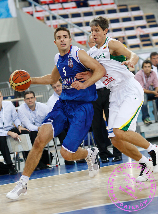 Lodz 16/09/2009.EuroBasket 2009.Qualifying Round - Group F.Lithuania v Serbia.Milenko Tepic of Serbia and Mindaugas Lukauskis of Lithuania ..Photo by : Piotr Hawalej / WROFOTO