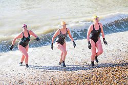© Licensed to London News Pictures. 17/02/2018. Brighton, UK. Members of the Brighton Swimming Club go for a swim in the sea in Brighton and Hove as sunny and milder weather is hitting the seaside resort. Photo credit: Hugo Michiels/LNP