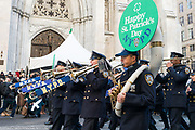 The New York City Police Department band marching in front of St. Patrick's Cathedral during the St. Patrick's Day Parade in New York City.
