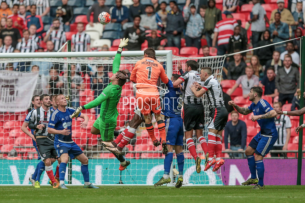 Jordan Porter (Halifax) tries to reach the ball with his opposite number James McKeown (Grimsby Town) trying to get a header in from the corner in the last few seconds of the FA Trophy match between Grimsby Town FC and Halifax Town at Wembley Stadium, London, England on 22 May 2016. Photo by Mark P Doherty.