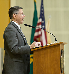 President Thomas Krise welcomes soldiers of JBLM to a Thanksgiving Dinner held in Chris Knutzen hall of the Anderson University center on Wednesday, Nov. 26, 2014. (Photo/John Froschauer)