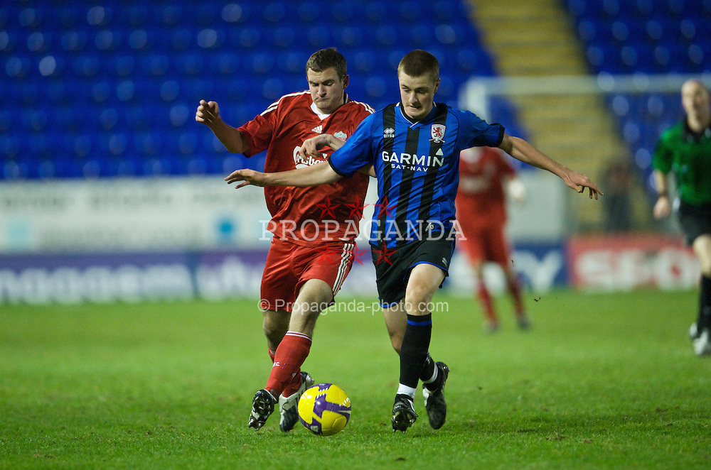 WARRINGTON, ENGLAND - Tuesday, January 20, 2009: Liverpool's Andras Simon in action against Middlesbrough's Jordan Robinson during the FA Premiership Reserves League (Northern Division) match at the Halliwell Jones Stadium. (Mandatory credit: David Rawcliffe/Propaganda)