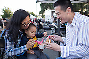 Eliza and her husband Thomas eat ice cream with their son Jake, 2, during Off the Grid at the Great Mall of the Bay Area in Milpitas, California, on May 12, 2016. (Stan Olszewski/SOSKIphoto)
