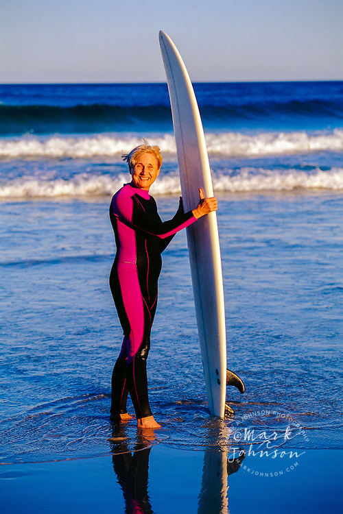 Senior Woman Surfer at Beach