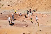 Visitors collect coloured sand at Makhtesh Ramon, Negev, Israel