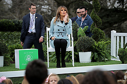 "WASHINGTON, DC - APRIL 02: (AFP OUT) U.S. first lady Melania Trump reads the book ""You,"" by Sandra Magsamen during the 140th annual Easter Egg Roll on the South Lawn of the White House April 2, 2018 in Washington, DC. The White House said they are expecting 30,000 children and adults to participate in the annual tradition of rolling colored eggs down the White House lawn that was started by President Rutherford B. Hayes in 1878. (Photo by Chip Somodevilla/Getty Images)"