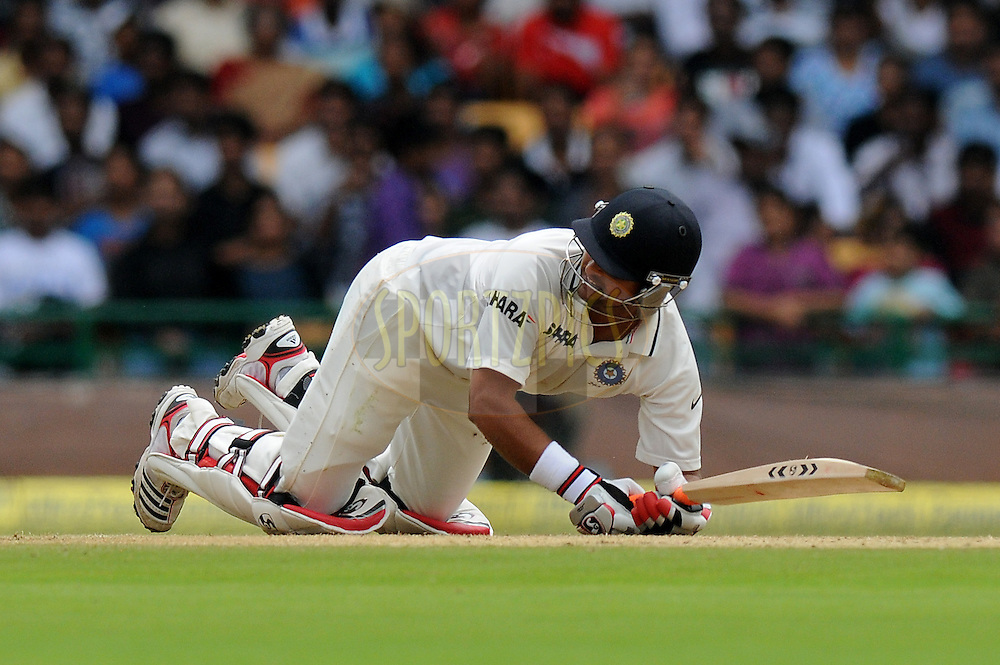 Suresh Raina of India slips as he hits a shot during day two of the second test match between India and New Zealand held at the M. Chinnaswamy Stadium, Bengaluru on the 1st September 2012..Photo by Pal Pillai/BCCI/SPORTZPICS