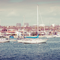 Panorama of Newport Beach skyline office buildings and boats over Newport Harbor. Newport Beach is a wealthy beach community along the Pacific Ocean in Southern California. Panoramic photo is high resolution and was taken in 2012.
