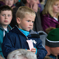 Jayden Murray from Quilty watching the pig race at the Kilmihil Festival of Fun Pig Racing 2015