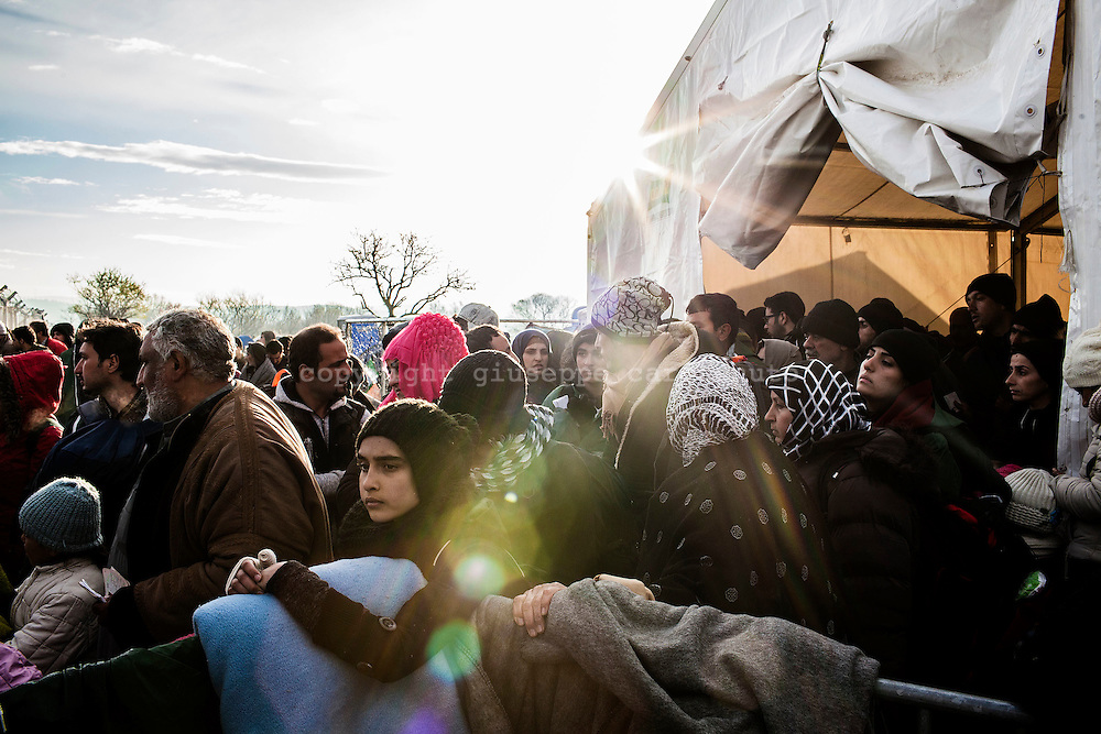 04 March 2016, Greece, Idomeni - Migrants and refugees wait to cross the Greek-Macedonian border near the village of Idomeni.