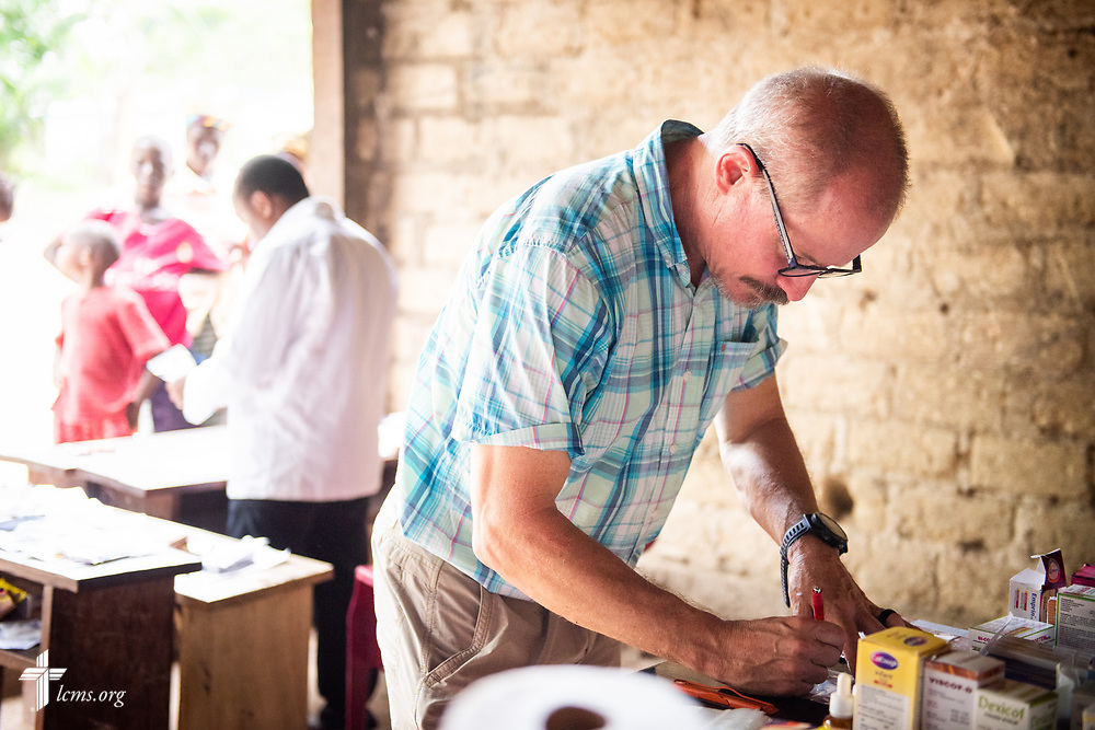 The Rev. Gary Schulte, area director for West and Central Africa, works in the pharmacy on the third day of the LCMS Mercy Medical Team on Wednesday, May 9, 2018, in the Yardu village outside Koidu, Sierra Leone, West Africa. LCMS Communications/Erik M. Lunsford