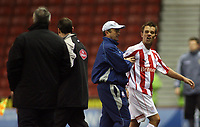 Photo: Paul Thomas.<br /> Stoke City v Cardiff City. Coca Cola Championship. 28/11/2006.<br /> <br /> Stoke's Lee Hendrie (R) is lead away by his manager Tony Pulis as he has very strong words to Cardiff manager Dave Jones (Far L).