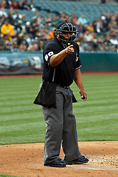 OAKLAND, CA - JUNE 10:  MLB umpire Adrian Johnson #80 calls a strike during the first inning between the Oakland Athletics and the Texas Rangers at O.co Coliseum on June 10, 2015 in Oakland, California. The Oakland Athletics defeated the Texas Rangers 5-4. (Photo by Jason O. Watson/Getty Images) *** Local Caption *** Adrian Johnson