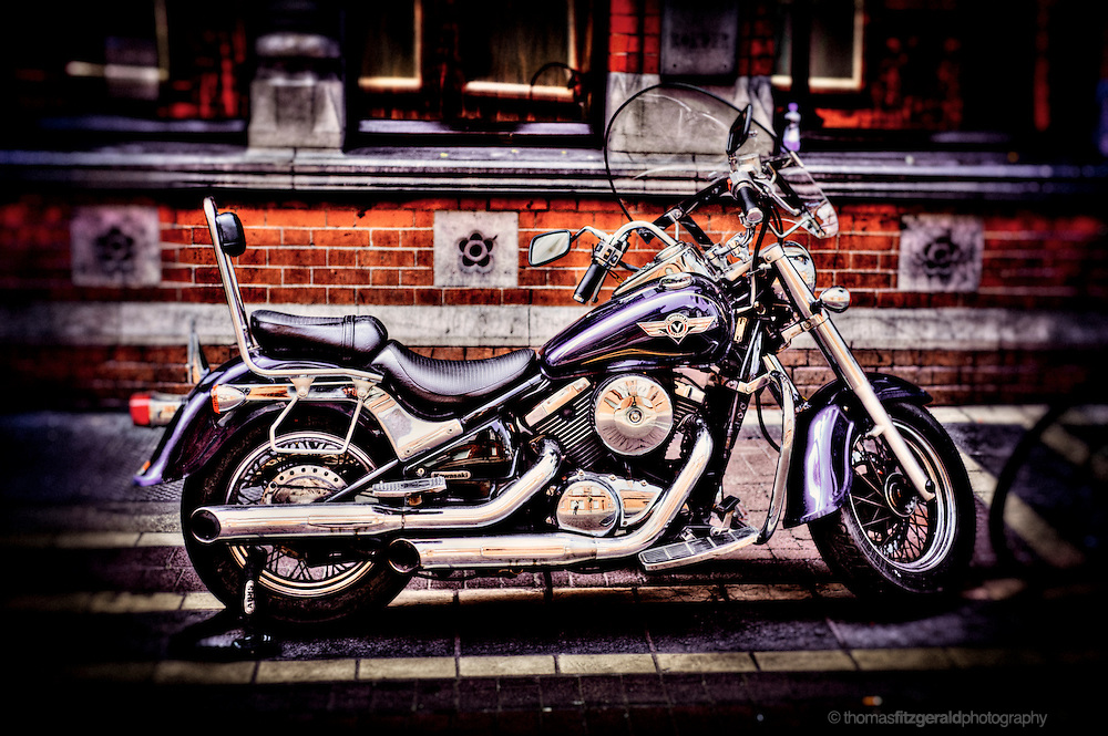 A HDR image of a motorcycle parked