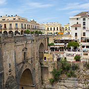 Ronda, Spain, is a lovely town in the province of Malaga, within the community of Andalusia. This photograph is shot from the Puente Nuevo that spans the 120 meter deep chasm.<br />