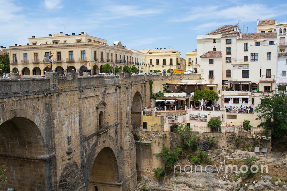 Ronda, Spain, is a lovely town in the province of Malaga, within the community of Andalusia. This photograph is shot from the Puente Nuevo that spans the 120 meter deep chasm.<br /> <br /> For all details about sizes, paper and pricing starting at $85, click &quot;Add to Cart&quot; below.