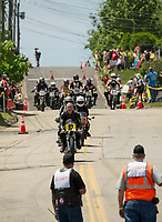Lead by Paul Leone riders come down Tower Hill Road in between heats during the Tower Hill Climb on Tuesday in Weirs Beach.  (Karen Bobotas/for the Laconia Daily Sun)