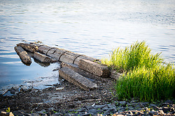 Old construction pipe running into river.