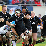 All Black Jeremy Rush powers past Eagle defenders toward the try line.  The legendary New Zealand All Blacks defeated the USA Eagles 74-6 at Soldier Field, Chicago, Illinois, USA.  Photo by Barry Markowitz, (Courtesy STP/TriMarine) 11/1/14, 3pm