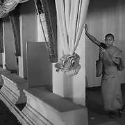 Novice monk takes a picture with his mobile phone at Pha That Luang in Vientiane, Laos.