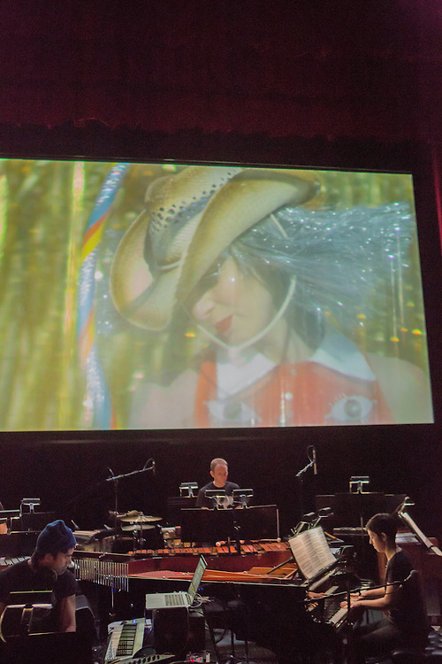 Brooklyn, NY - 20 January 2015. The dress rehearsal of Sufjan Stevens' Round-Up, with slow motion film of the Pendleton, Oregon Round-Up by Aaron and Alex Craig, music performd by Sufjan Stevens and Yarn/Wire. Musicians (L to R)  Sufjan Stevens (in the blue cap), Ian Antonio, Laura Barger (piano).