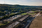 Drone aerial of the Hazelwood neighborhood of Pittsburgh. <br /> <br /> The Jones & Laughlin Steel Company (J&L Company) built their first industrial plants along the Monongahela River in 1883. With plants along both sides of the River, on the South Side and in Hazelwood, the site became an industrial hub. Further development of the area included important infrastructure investments, such as the construction of the Hot Metal Bridge in 1884 to connect the two plants owned and run by J&L Company. During WWII, the area was producing so much steel that the Hot Metal Bridge was the second most heavily guarded piece of infrastructure in the United States.<br /> <br /> By the late 19th century Hazelwood was a bustling town. In the 1950s the neighborhood was host to over 200 businesses. It had become home to large Hungarian, Italian, Slovak, Carpatho-Rusin, Polish, and Irish populations. With the construction of the Civic Arena in the Hill District large African-American populations made Hazelwood a home.<br /> <br /> In the 1980s the steel industry began to decline. As the industry packed up, so did business and many residents. Like many areas in the rust-belt, Hazelwood fell into disrepair. Hazelwood was home to the city of Pittsburgh's last operating steel mill, the Hazelwood Coke Works, which was owned by Jones and Laughlin and later, its parent company, LTV, when it closed in 1998.