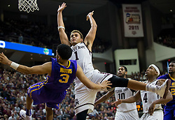 LSU guard Tremont Waters (3) is fouled by Texas A&M forward DJ Hogg (1) during the second half of an NCAA college basketball game Saturday, Jan. 6, 2018, in College Station, Texas. (AP Photo/Sam Craft)