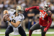 NEW ORLEANS, LA - SEPTEMBER 20:  Drew Brees #9 of the New Orleans Saints tries to avoid the rush during a game against the Tampa Bay Buccaneers at Mercedes-Benz Superdome on September 20, 2015 in New Orleans Louisiana.  The Buccaneers defeated the Saints 26-19.  (Photo by Wesley Hitt/Getty Images) *** Local Caption *** Drew Brees