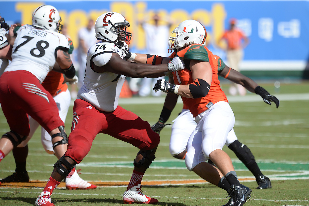 October 11, 2014: Justin Murray #74 of the Cincinnati Bearcats looks to block Anthony Chickillo #71 of the Miami Hurricanes during the football game between the Cincinnati Bearcats and the Miami Hurricanes at Sun Life Stadium in Miami Gardens, FL. The Hurricanes defeated the Bearcats 55-34.