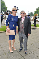 WILLIE CARSON and his wife ELAINE at the Investec Derby at Epsom Racecourse, Epsom, Surrey on 4th June 2016.