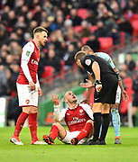 Jack Wilshere (10) of Arsenal is upset that he was not awarded a free kick by referee Craig Pawson during the EFL Cup Final match between Arsenal and Manchester City at Wembley Stadium, London, England on 25 February 2018. Picture by Graham Hunt.