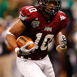 December 18, 2010; New Orleans, LA, USA; Troy Trojans wide receiver Tebiarus Gill (10) runs after a catch for a touchdown against the Ohio Bobcats during the first half of the 2010 New Orleans Bowl at the Louisiana Superdome.  Mandatory Credit: Derick E. Hingle