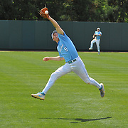 UNC shortstop Michael Russell (5) makes a leaping catch for an out.