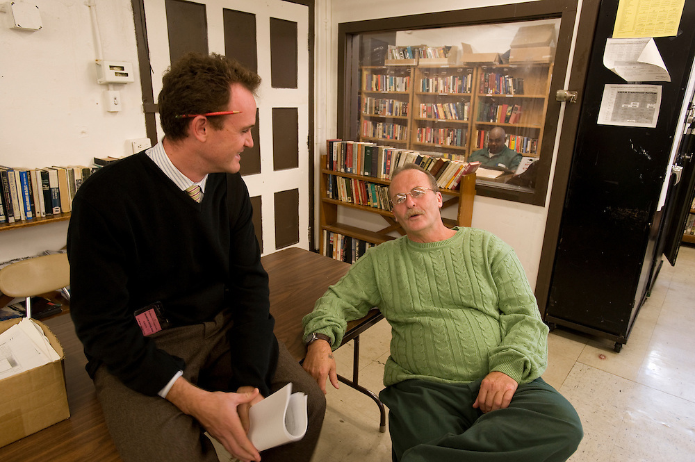 """Max Kenner (left) with inmate and Bard College graduate Bill Doane (55) in the computer room at Woodbourne Correctional Facility. Max is the brainchild behind the privately funded Bard College  Initiative for prison inmates. Bill, who graduated from Bard in 2008, was sentenced to 24 years in prison..In the back room: Inmate Stacey C. Williams studies in the library...Story: The Bard Prison Initiative.Former inmate Carlos Rosario, 35-year-old husband and father of four, was released from Woodbourne Correctional Facility after serving more than 12 years for armed robbery. Rosado is one of the students participating in the Bard Prison Initiative, a privately-funded program that offers inmates at five New York State prisons the opportunity to work toward a college degree from Bard College. The program, which is the brainchild of alumnus Max Kenner, is competitive, accepting only 15 new students at each facility every other year. .Carlos Rosario received the Bachelor of Arts degree in social studies from the prestigious College Saturday, just a few days after his release. He had been working on it for the last six years. His senior thesis was titled """"The Diet of Punishment: Prison Food and Penal Practice in the Post-Rehabilitative Era,"""".Rosado is credited with developing a garden in one of the few green spaces inside the otherwise cement-heavy prison. In the two years since the garden's foundation, it has provided some of the only access the prison's 800 inmates have to fresh vegetables and fruit...Rosario now works for a recycling company in Poughkeepsie, N.Y...Photo © Stefan Falke"""