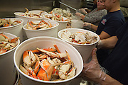 Spring Valley Volunteer Fire Department members prepare buckets of crab during the Milpitas Chamber of Commerce 21st Annual Auction & Crab Feed at Napredak Hall in San Jose, California, on March 7, 2014. (Stan Olszewski/SOSKIphoto)