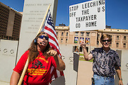 25 JUNE 2012 - PHOENIX, AZ:   ALLISON CULVER, a support of Arizona's SB1070, shouts at opponents at the Arizona State Capitol of the law after the US Supreme Court overturned most of the law Monday. The case, US v. Arizona, determined whether or not Arizona's tough anti-immigration law, popularly known as SB1070 was constitutional. The court struck down most of the law but left one section standing, the section authorizing local police agencies to check the immigration status of people they come into contact with.    PHOTO BY JACK KURTZ